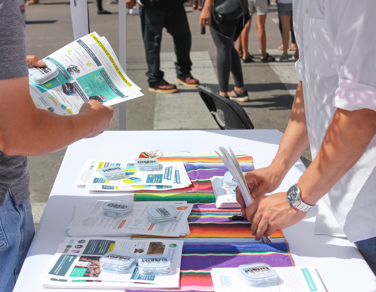 An interested festival attendee reads through the Careers in Energy infographics.